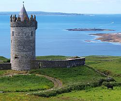 Doonagore Castle with a view to the Aran Islands